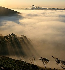 220px-San_francisco_in_fog_with_rays